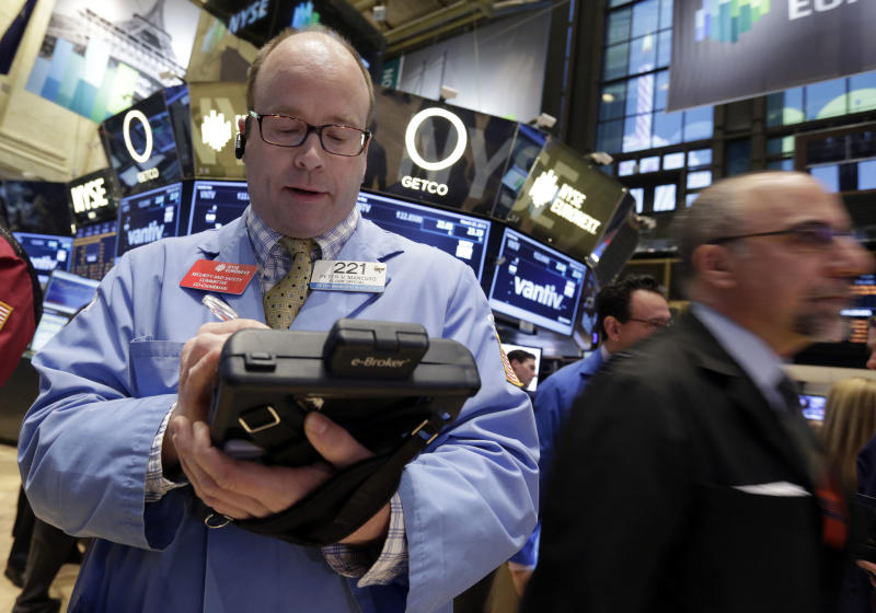 Trader Peter Mancuso, left, works on the floor of the New York Stock Exchange Monday, March 25, 2013. U.S. stock markets opened higher after Cyprus clinched a last-minute bailout that saved it from bankruptcy. (AP Photo/Richard Drew)