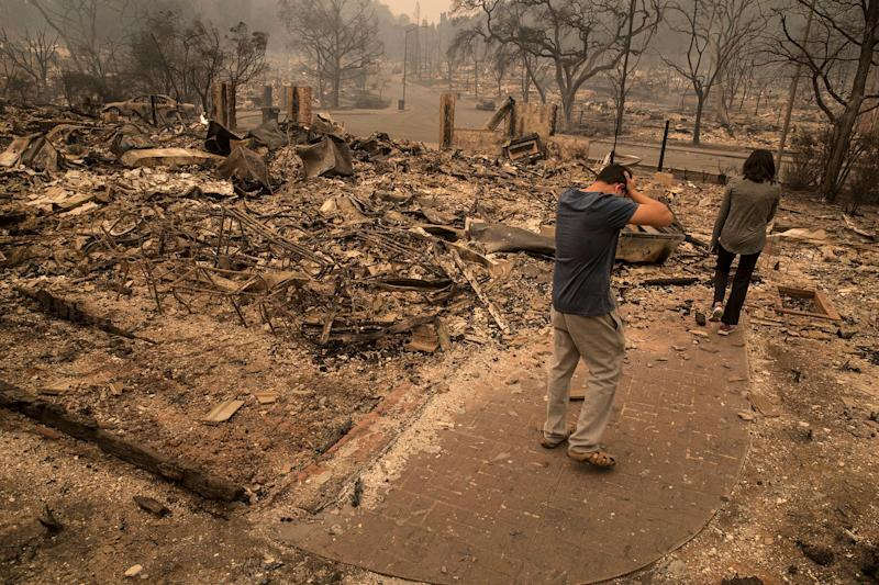 A Fountaingrove Village homeowner reacts as he surveys his destroyed home he has owned for four years in Santa Rosa, California.