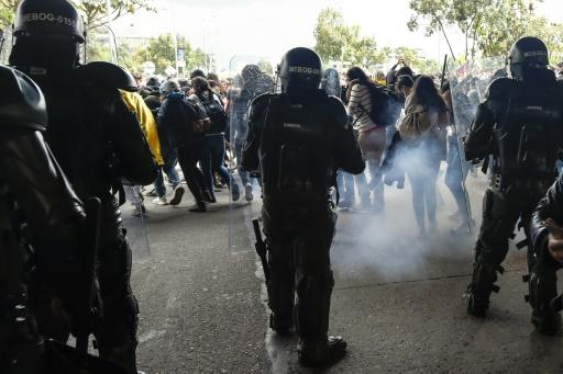 Riot police fire tear gas to disperse demonstrators in Bogota during a nationwide strike