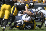 Las Vegas Raiders quarterback Derek Carr (4) is sacked by Pittsburgh Steelers linebacker Robert Spillane, top, and linebacker Alex Highsmith (56) during the first half of an NFL football game in Pittsburgh, Sunday, Sept. 19, 2021. (AP Photo/Don Wright)