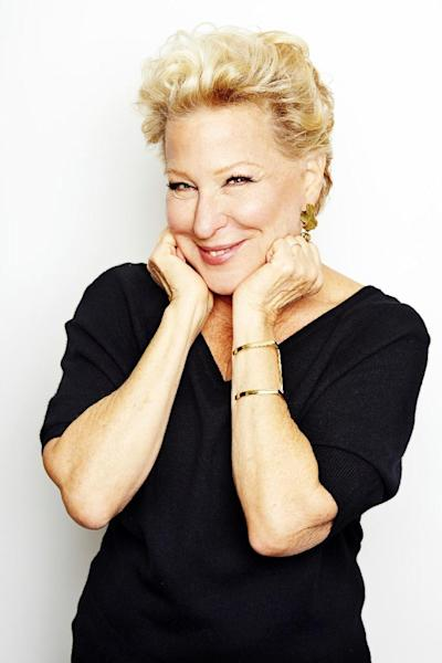 "FILE - In this Oct. 7, 2014 file photo, Bette Midler poses for a portrait in New York. The Grammy- and Emmy Award-winner is re-releasing a deluxe version of ""The Divine Miss M,"" her 1972 debut album that included the hits ""Do You Want To Dance,"" ""Chapel Of Love,"" ""Friends"" and ""Boogie Woogie Bugle Boy."" (Photo by Dan Hallman/Invision/AP)"