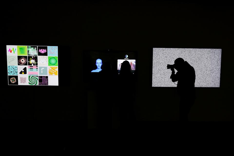 """""""Natively Digital: A Curated NFT Sale' auction at Sotheby's in New York. NFTs can be anything digital from drawings and paintings to music, but they can also be applied to a physical item such as coins or a stamp. Photo: Shannon Stapleton/Reuters"""
