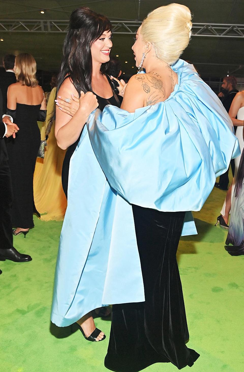 <p>Katy Perry and Lady Gaga share a sweet moment while attending the opening gala for the Academy Museum of Motion Pictures in Los Angeles on Sept. 25.</p>
