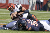Cincinnati Bengals quarterback Joe Burrow is sacked by Chicago Bears outside linebacker Khalil Mack (52) and Robert Quinn during the first half of an NFL football game Sunday, Sept. 19, 2021, in Chicago. (AP Photo/Nam Y. Huh)