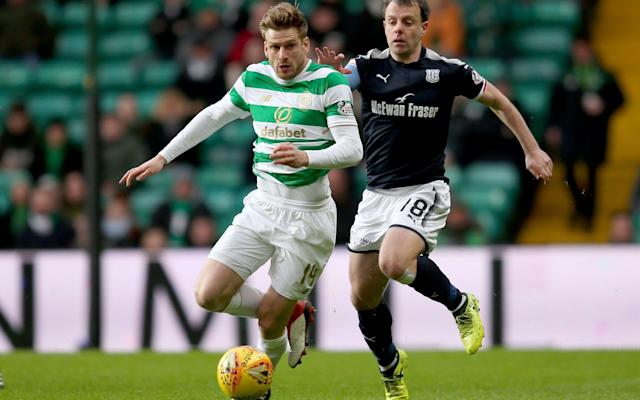 """Celtic began this fixture in need of nine points to secure their seventh successive Scottish title, perhaps even as early as Sunday. A dogged performance by Dundee, however, delayed the coronation until after the Scottish Premiership's split, the schedule of which will be announced next week. Arguably, the point secured by the visitors was arguably more valuable, given Ross County's emphatic victory over Partick Thistle on Tuesday, which threatened to suck Dundee into the relegation swamp. Having declared that Dundee had turned down a bid of £1.7 million from Rosenborg for Steven Caulker, despite his having made only six appearances since joining from Queen's Park Rangers in February, Neil McCann could not leave the defender out, even though the Norwegian transfer deadline had not expired and another offer could theoretically be received. The Englishman qualifies to play for Scotland through a grandmother and McCann urged Alex McLeish to consider securing the 26-year-old for the Scots. """"It was always in his mind to come up here and fall in love with the game again,"""" McCann said. """"I would love him to pull on the dark blue for Scotland. I would like to think he's open to that."""" Caulker was required for action from the start as Celtic pressed in a passage that climaxed when Moussa Dembele played a one-two with James Forrest to finish with a drive that was blocked by Elliot Parish. Parish's predecessor as Dundee goalkeeper, Scott Bain, who is on loan to Celtic, was deprived of his place at the other end of the field by the terms of the deal, which neatly left the way open for Craig Gordon to make his comeback after a two-month absence because of a knee injury. Gordon's match fitness was put to the test when Celtic's initial surge subsided and Simon Murray was able to reach the edge of the home penalty area to deliver a stinging attempt which the keeper fingertipped over his crossbar. The pattern continued throughout the rest of the first half with Celtic controlling the"""