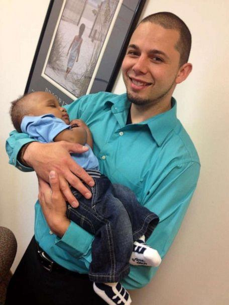 PHOTO: Shannon Fessenden of White Cloud, Michigan, is seen holding his son Mason, 2. (The Fessenden Family)