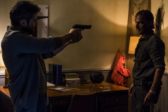 <p>Andrew Lincoln as Rick Grimes and Juan Gabriel Pareja as Morales in AMC's <i>The Walking Dead</i>.<br>(Photo: Gene Page/AMC) </p>