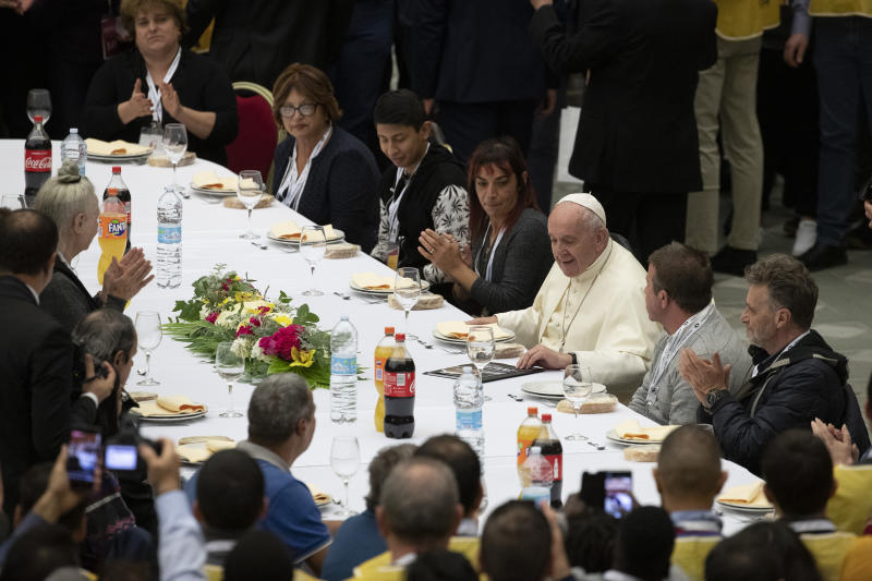 Pope Francis sits at a table during a lunch, in the Paul VI Hall at the Vatican, Sunday, Nov. 17, 2019. Pope Francis is offering several hundred poor people, homeless, migrants, unemployed a lunch on Sunday as he celebrates the World Day of the Poor with a concrete gesture of charity in the spirit of his namesake, St. Francis of Assisi. (AP Photo/Alessandra Tarantino)