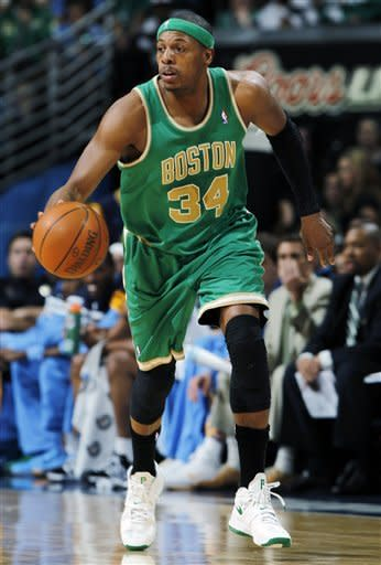 Boston Celtics forward Paul Pierce picks up a loose ball against the Denver Nuggets in the first quarter of an NBA basketball game in Denver on Saturday, March 17, 2012. (AP Photo/David Zalubowski)