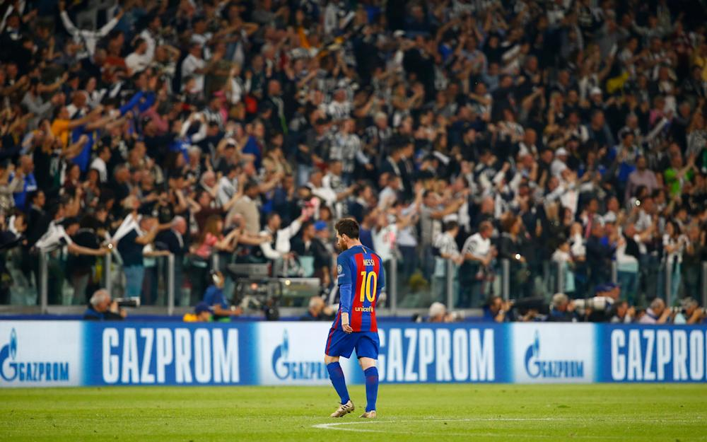 Lionel Messi looks dejected as Juventus fans celebrate - Credit: REUTERS