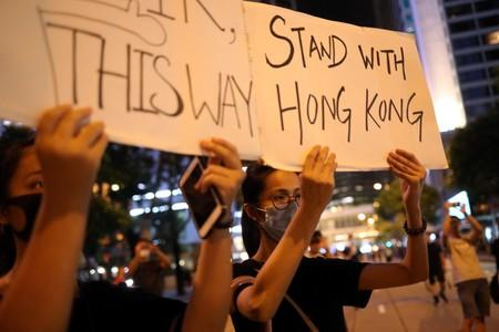 "Protesters attend a ""Stand With Hong Kong, Power to the People Rally"" at the Chater Garden, in Hong Kong"