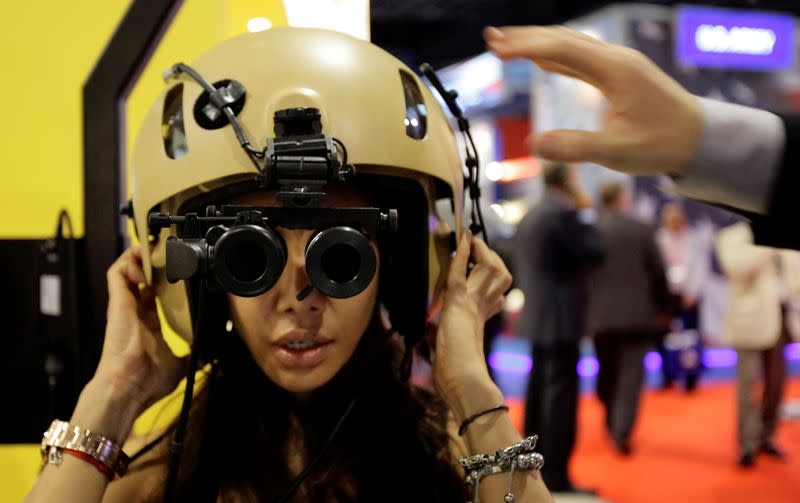 FILE PHOTO: A visitor tries on an ANVIS/HUD at the Elbit Systems booth at the Singapore Airshow in Singapore