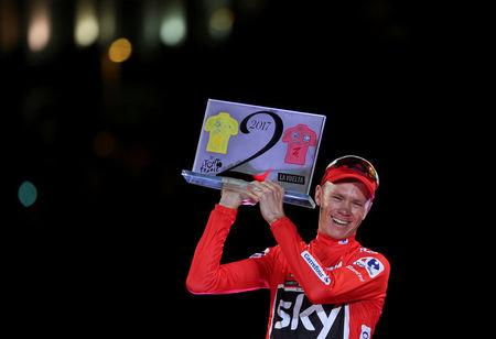 Team Sky rider Chris Froome of Britain holds a plaque as winner of both the Tour de France and Vuelta Tour of Spain after the last stage of the Vuelta between Arroyomolinos and Madrid, September 10, 2017. REUTERS/Susana Vera