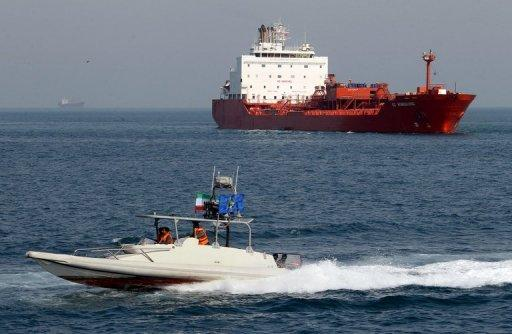 <p>An Iranian Revolutionary Guard speedboat cruises past an oil tanker off the port of Bandar Abbas, southern Iran. The US Congress approved punishing new sanctions targeting Iran's energy and shipbuilding sectors, a day after President Barack Obama unveiled measures to cripple Tehran's nuclear drive.</p>