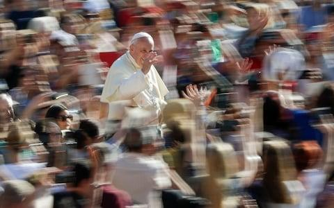 Pope Francis arrives for his weekly general audience, at the Vatican, Wednesday, Sept. 11 - Credit: AP