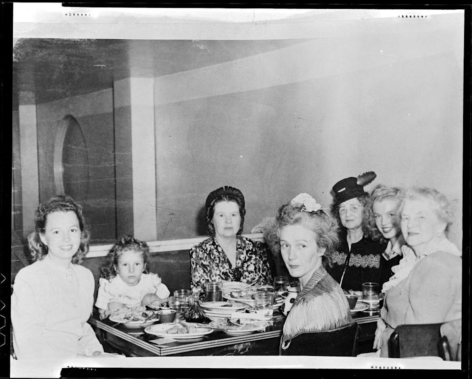 <p>Norma did see extended family members at times. Here, they're at a restaurant with Norma on the far right, center. </p>
