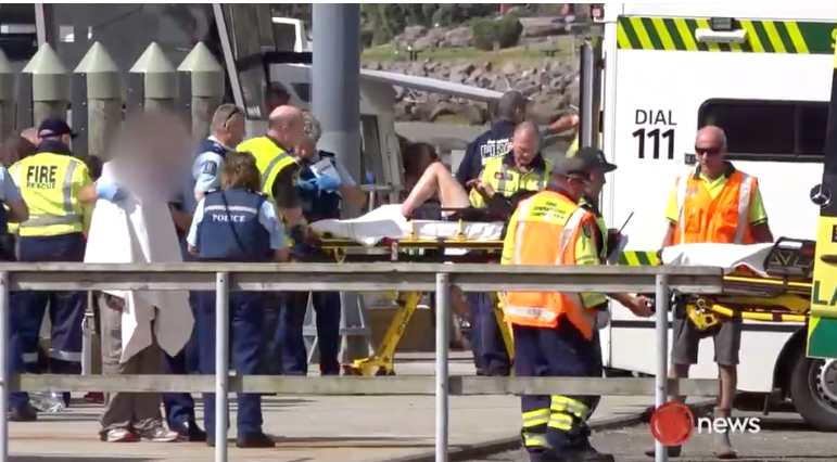 A person is taken on a stretcher into an ambulance.