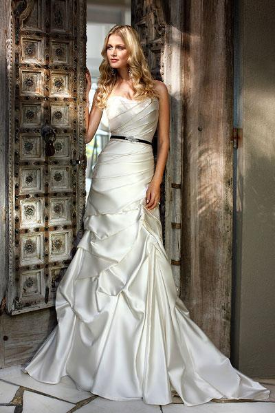 """<div class=""""caption-credit""""> Photo by: Ella Bridals</div><div class=""""caption-title"""">17. Ella Bridals</div>With soft pickups and a fashion-forward black sash, this fit-and-flare by Ella Bridals has an easygoing vibe that is ideal for destination nuptials. <br> <br> Check out more gorgeous styles in our <a rel=""""nofollow noopener"""" href=""""http://www.bridalguide.com/photo-galleries/bridal-gowns/ella-bridals/style-5436"""" target=""""_blank"""" data-ylk=""""slk:Ella Bridals gown gallery"""" class=""""link rapid-noclick-resp"""">Ella Bridals gown gallery</a>!"""