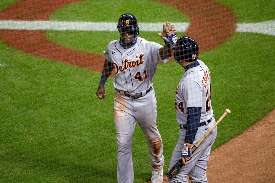 Detroit Tigers right fielder Daz Cameron (41) celebrates with designated hitter Miguel Cabrera after scoring a run in the seventh inning against the Minnesota Twins at Target Field, Sept. 22, 2020.