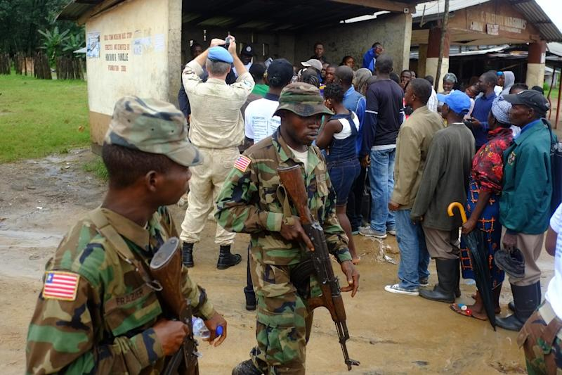 Liberian soldiers patrol Dolo Town, quarantined two weeks ago to limit the spread of Ebola (AFP Photo/Dominique Faget)