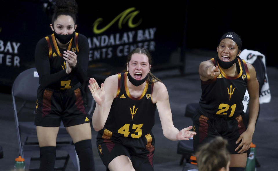 Arizona State's Gabriela Bosquez, (3) Imogen Greenslade (43) and Sydnei Caldwell (21) react after a foul call during an NCAA college basketball game against Southern California in the first round of the Pac-12 women's tournament Wednesday, March 3, 2021, in Las Vegas. (AP Photo/Isaac Brekken)