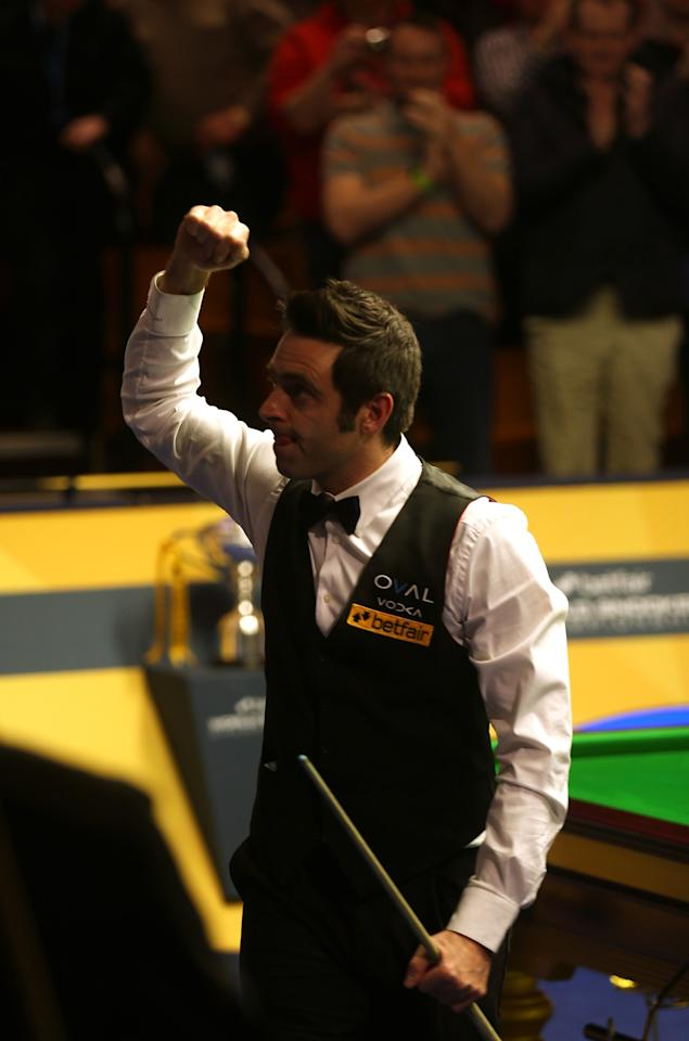 SHEFFIELD, ENGLAND - MAY 04:  Ronnie O'Sullivan of England celebrates beating Judd Trump of England during the Semi Final match of the Betfair World Snooker Championship at the Crucible Theatre on May 4, 2013 in Sheffield, England.  (Photo by Warren Little/Getty Images)