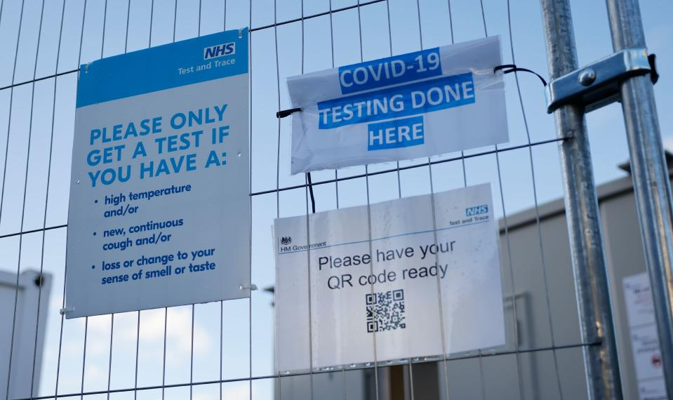 """A sign is pictured on a fence outside a novel coronavirus COVID-19 walk-in testing centre in Walthamstow in north east London, on December 15, 2020. - Two leading British medical journals urged the government Tuesday to scrap plans to ease coronavirus restrictions over Christmas, warning it would be """"another major error that will cost many lives"""". The British capital faces tougher Covid-19 measures within days, the UK government said on Monday, with a new coronavirus variant emerging as a possible cause for rapidly rising infection rates. (Photo by Tolga Akmen / AFP) (Photo by TOLGA AKMEN/AFP via Getty Images)"""