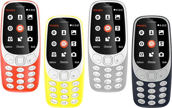 Four Nokia 3310 phones displayed in red, yellow, gray, and black.