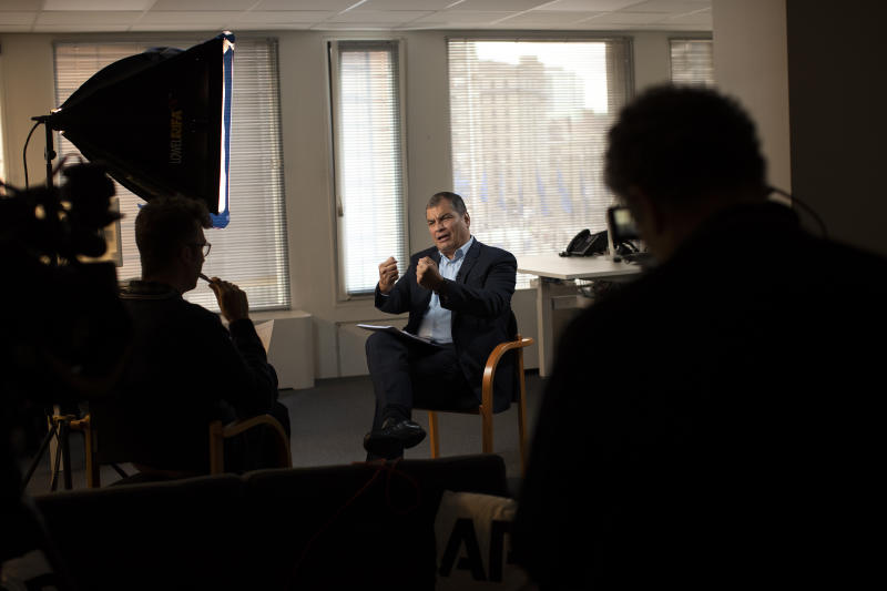 "Former Ecuador President Rafael Correa gestures during an interview with Associated Press in Brussels, Thursday, Oct. 10, 2019. Correa is dismissing as ""nonsense"" allegations that he is plotting with Venezuela President Nicolas Maduro to destabilize the current Ecuador government amid violent unrest sparked by fuel price hikes. (AP Photo/Francisco Seco)"