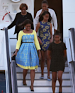 """<p>Across the pond to promote Let Girls Learn, Michelle Obama made her grand entrance to the United Kingdom wearing a yellow and robin's egg blue fit and flare dress. Designed by Preen by Thornton Bregazzi, this dress was modified from a similar version from the <a rel=""""nofollow noopener"""" href=""""http://www.avenue32.com/blue-lace-lou-dress-51101/?utm_source=polyvore&utm_medium=affiliate&utm_campaign=day+dresses¤cy=2&utm_source=LinkShare&utm_medium=Affiliate&utm_campaign=USNetwork&utm_term=QFGLnEolOWg&utm_content=15&mid=37532&siteID=QFGLnEolOWg-fa838jXUyhajz4SSDyMqUQ"""" target=""""_blank"""" data-ylk=""""slk:Resort 2015 collection"""" class=""""link rapid-noclick-resp"""">Resort 2015 collection</a>. </p>"""