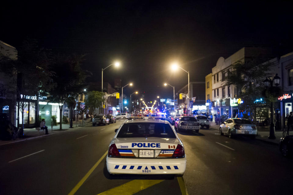 <em>Police secure the perimeter around the scene of the shooting in Toronto (AP)</em>