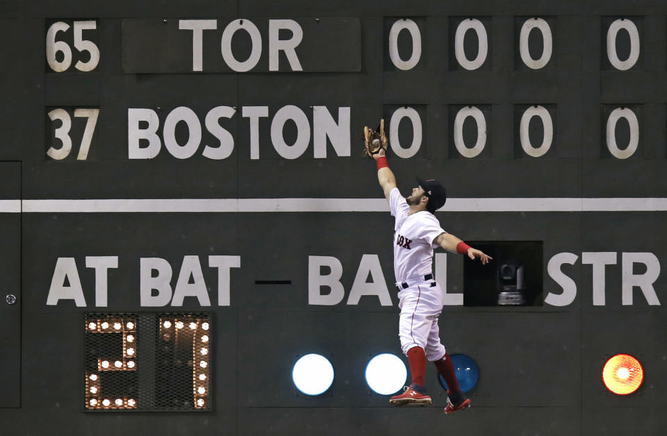Boston Red Sox left fielder Andrew Benintendi grabs a fly out by Toronto Blue Jays' Dwight Smith Jr. during the ninth inning of a baseball game at Fenway Park in Boston, Tuesday, Sept. 11, 2018. Boston won 7-2. (AP Photo/Charles Krupa)