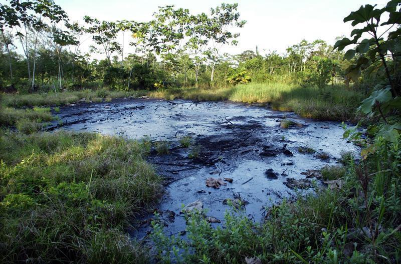 TEXACO OIL WASTE PIT IN THE AMAZON.