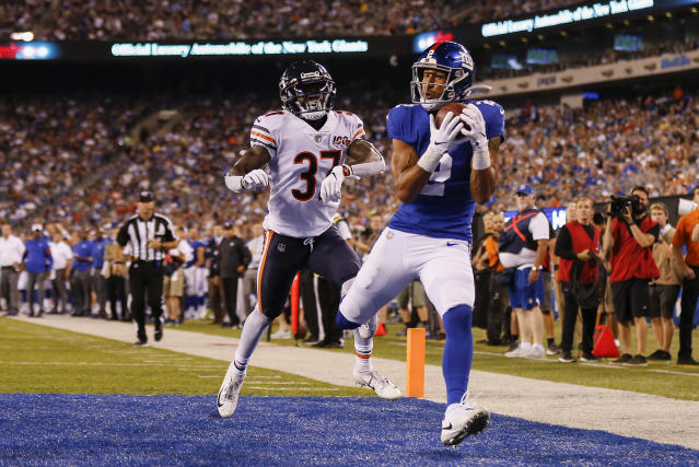 CORRECTS TO GIANTS' TJ JONES NOT ALDRICK ROSAS - New York Giants' TJ Jones, right, catches a pass for a touchdown against Chicago Bears defensive back John Franklin (37) during the second quarter of a preseason NFL football game Friday, Aug. 16, 2019, in East Rutherford, N.J. (AP Photo/Adam Hunger)