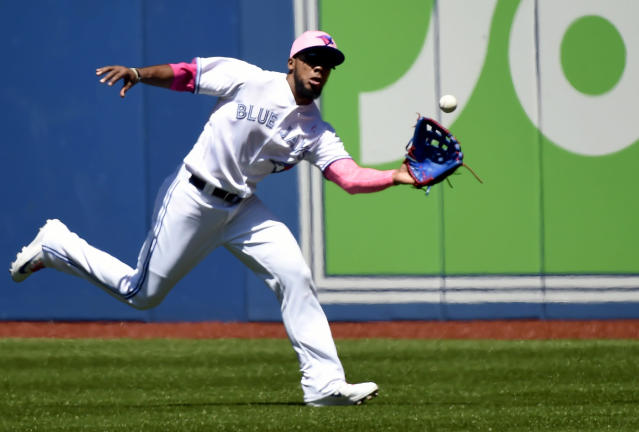 Toronto Blue Jays right fielder Teoscar Hernandez makes a running catch during second-inning baseball game action against the Boston Red Sox in Toronto, Sunday, May 13, 2018. (Nathan Denette/The Canadian Press via AP)