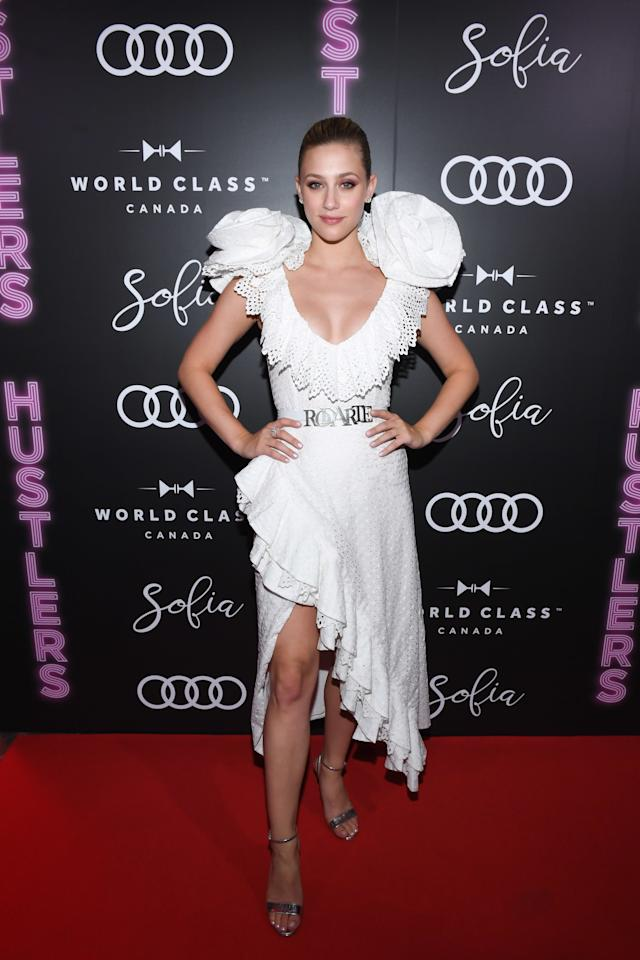 While at the Toronto International Film Festival, Lili slayed the red carpet game in a ruffled white Rodarte dress complete with metal logo belt and standout, voluminous floral sleeves.