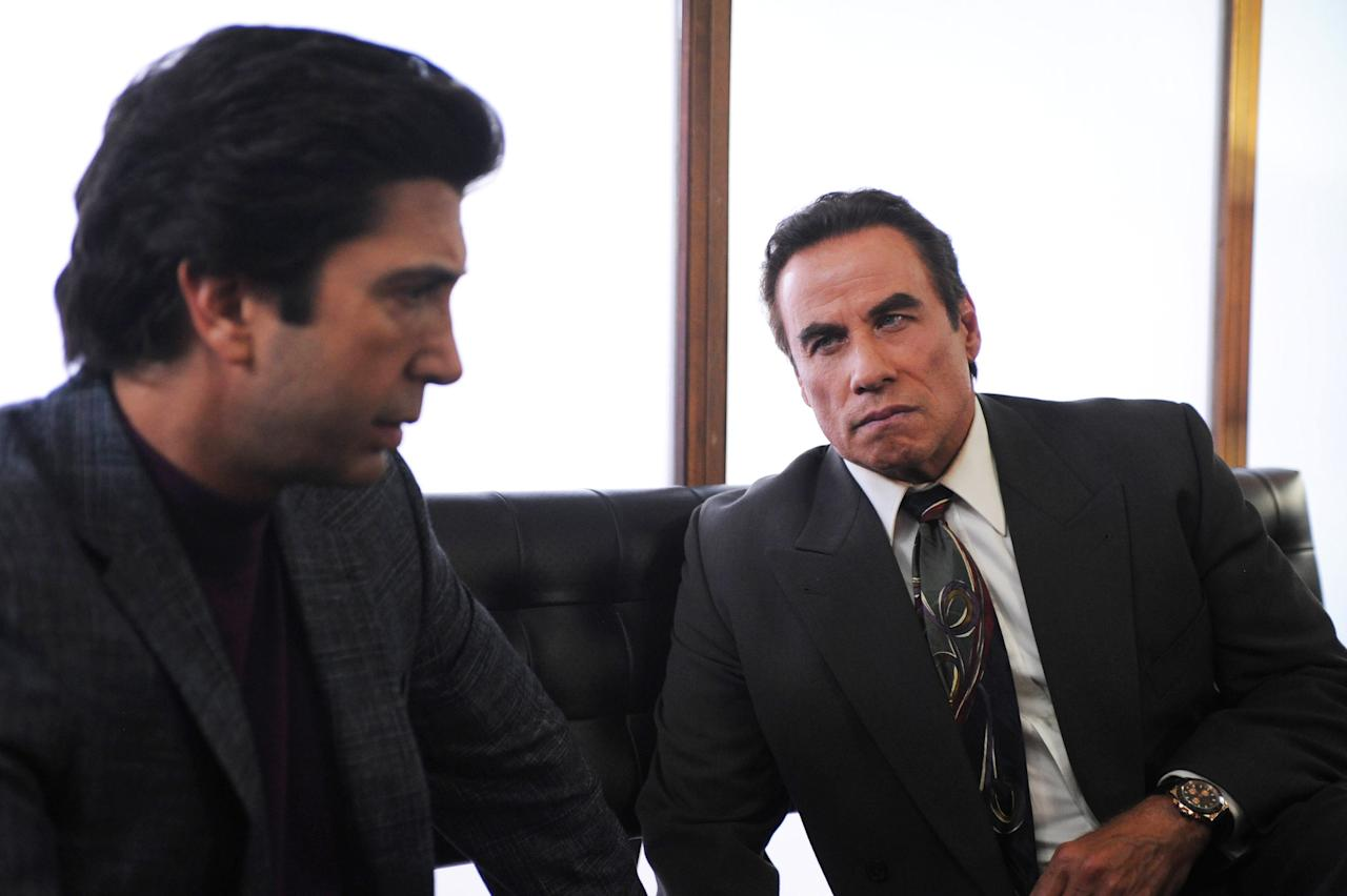 "In this image released by FX, David Schwimmer portrays Robert Kardashian, left, and John Travolta portrays Robert Shapiro, in a scene from ""The People v. O.J. Simpson: American Crime Story,"" a 10-part series debuting Tuesday, Feb. 2, at 10 p.m. EST Tuesday.  (Ray Mickshaw/FX via AP)"