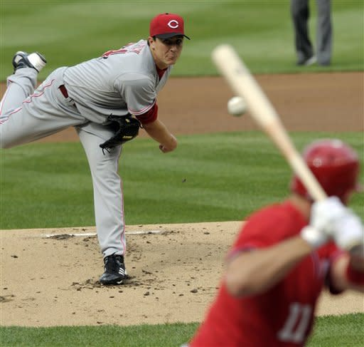 Cincinnati Reds starting pitcher Homer Bailey throws a pitch to Washington Nationals' Ryan Zimmerman during the first inning of their baseball game in Washington, Saturday, April 14, 2012. (AP Photo/Susan Walsh)