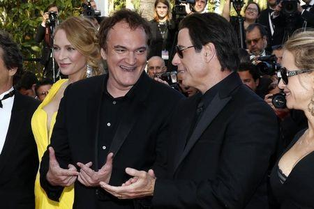 """Director Quentin Tarantino, actress Uma Thurman and actor John Travolta pose on the red carpet they arrive for the screening of the film """"Sils Maria"""" in competition at the 67th Cannes Film Festival in Cannes"""
