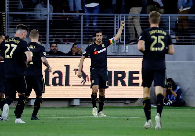 Los Angeles FC forward Carlos Vela (10) celebrates his goal against the Montreal Impact during the first half of an MLS soccer match in Los Angeles, Friday, May 24, 2019. (AP Photo/Ringo H.W. Chiu)