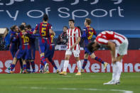 FC Barcelona players celebrate after scoring the opening goal during the Spanish Supercopa final soccer match between FC Barcelona and Athletic Bilbao at La Cartuja stadium in Seville, Spain, Sunday, Jan. 17, 2021. (AP Photo/Miguel Morenatti)