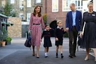 <p>George and Charlotte make their way into the building for their first official day. </p>