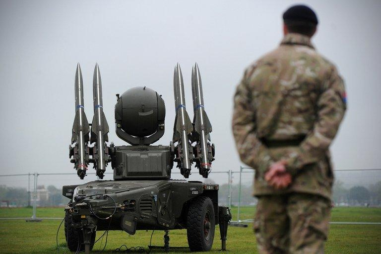 """A soldier from the Royal Artillery looks on as a Rapier missile defence system, deployed to provide air security for the Olympics, is shown to members of the media at Blackheath in London on May 3, 2012. The British military's dependence on information technology means it could be """"fatally compromised"""" by a cyber-attack but the government seems unprepared, lawmakers warned Wednesday"""