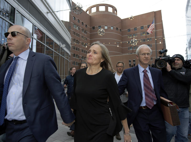 District Court Judge Shelley M. Richmond Joseph, center, departs federal court, Thursday, April 25, 2019, in Boston after facing obstruction of justice charges for allegedly helping a man in the country illegally evade immigration officials as he left her Newton, Mass., courthouse after a hearing in 2018. (AP Photo/Steven Senne)