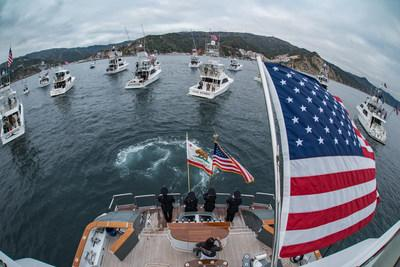 In the waters just off Avalon Harbor, the 18 participating yachts of the Second Annual War Heroes on Water Sportfishing Tournament gather around the host yacht, Bad Company 144, for the presentation of the American flag by the LAPD Color Guard ahead of the Tournament's shotgun start.
