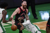 Toronto Raptors center Aron Baynes (46) yells as he is fouled by Boston Celtics guard Jaylen Brown (7) during the first half of an NBA basketball game, Thursday, March 4, 2021, in Boston. (AP Photo/Charles Krupa)