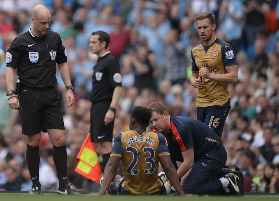 Arsenal will be without England forward Danny Welbeck, who has been ruled out for nine months after picking up a knee injury at Manchester City last weekend (AFP Photo/Oli Scarff )