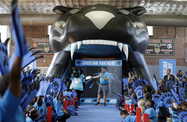 "Carolina Panthers owner David Tepper speaks to students during a ""kickoff rally"" at Thomasboro Academy in Charlotte, N.C., Tuesday, Aug. 28, 2018. Tepper's charitable foundation along with several players groups and other partners will provide 12,000 backpacks full of supplies to 17 elementary schools in Charlotte-Mecklenburg Schools, as well as an additional school in Kannapolis City Schools. (AP Photo/Chuck Burton)"