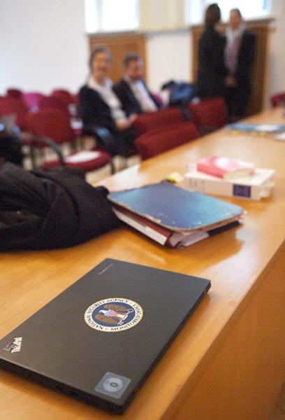 """A lawyer's laptop with a sticker reading """" National Security Agency monitored device"""" lies on a table in the courtroom at the Administrative Court in Cologne, western Germany (AFP Photo/Patrik Stollarz)"""