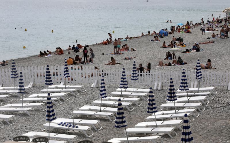 Deckchairs are aligned respecting social distancing on a private beach in Nice